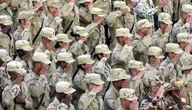 (file photo) US soldiers salute during a flag lowering ceremony at the Bagram Air Base in Afghanista