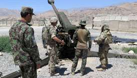 U.S. military advisers from the 1st Security Force Assistance Brigade work with Afghan soldiers at a