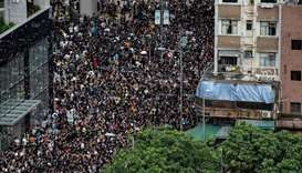 People attend a march at Mong Kok district in Hong Kong