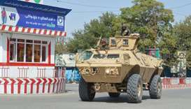 Afghan security forces patrol an area during a Taliban attack in the downtown of Kunduz city, Afghan