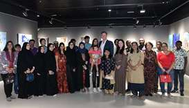 GROUP: Artists, guests and organisers of the exhibition pose for a group photo.