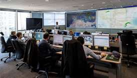 Employees working in the situation room at the headquarters of the European Union border force Front