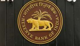 CCTV cameras are seen installed above the logo of Reserve Bank of India (RBI) inside its headquarter