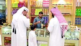 Customers at a perfume and incense shop.