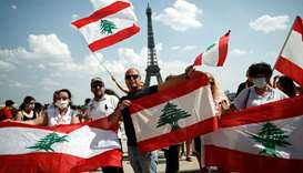 People gather at the Trocadero square near the Eiffel Tower to support the people of Lebanon after B