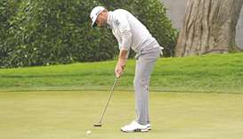 Dustin Johnson putts on the 18th green during the third round of the 2020 PGA Championship golf tour