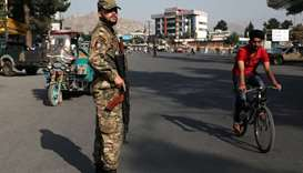 An Afghan policeman stands guard at a check point in Kabul, Afghanistan