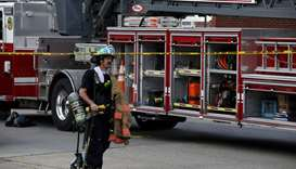 A firefighter is seen at the scene of an explosion in a residential area of Baltimore, Maryland, US
