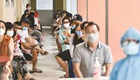 Residents wait to be tested