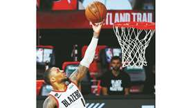 Damian Lillard of the Portland Trail Blazers goers up for a shot against the Philadelphia 76ers duri