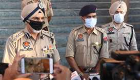 Punjab Director General of Police Hardial Singh Mann (left) and other police officers speak to repor