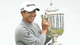 Collin Morikawa poses with the Wanamaker Trophy after winning the 2020 PGA Championship golf tournam