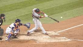 Washington Nationals catcher Yan Gomes (10) hits a single during the top of the fifth inning against