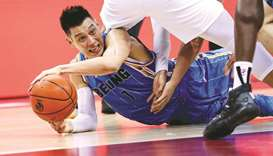 This file photo taken on August 4 shows Beijing Ducks' Jeremy Lin falling during the Chinese Basketb