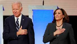 Former Vice President Joe Biden and US Senator Kamala Harris take the stage before the start of the