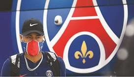 Paris Saint-Germain's Brazilian forward Neymar arrives at the team hotel in Lisbon yesterday, on the