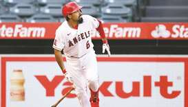 Los Angeles Angels infielder Anthony Rendon hits a two-run home run against the Oakland Athletics at