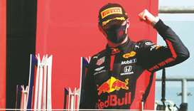 Red Bull driver Max Verstappen celebrates on the podium after winning the 70th Anniversary Grand Pri