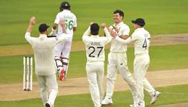 England's James Anderson (second from right) celebrates with teammates after taking the wicket of Pa