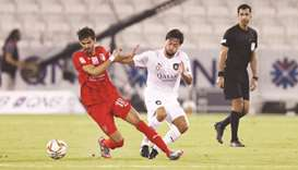 Al Sadd's Rodrigo Tabata (right) and Al Duhail's Sultan al-Brake vie for the ball during their QNB S