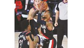 Portland Trail Blazers guard Damian Lillard shoots a three point basket against the Dallas Mavericks