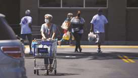 Shoppers leave a Walmart store in Lakewood, California. Retail sales have been rebounding in the US