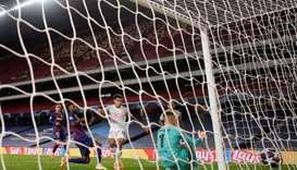 Bayern Munich's Philippe Coutinho scores their eighth goal, as play resumes behind closed doors foll