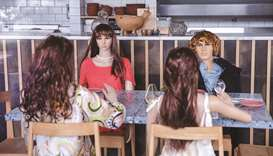 A cafe forced to close under restrictions places mannequins at the tables to mimic customers in Auck