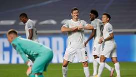 Bayern Munich's Robert Lewandowski celebrates scoring their sixth goal, as play resumes behind close