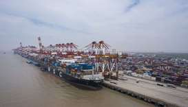 Vessels sit loaded with shipping containers at the Yangshan Deepwater Port in this aerial photograph