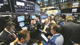 Traders work on the floor at the New York Stock Exchange (file). Investors are girding their portfol