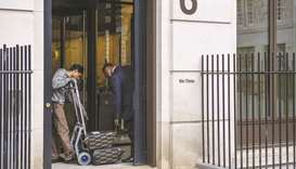 A courier delivers parcels to the Rio Tinto offices in London. Rio must decide whether it's prepared