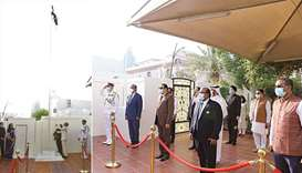Indian ambassador Dr Deepak Mittal hoisting the national flag on the embassy premises; Guests at the