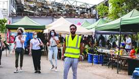 Ziad Nassar (in yellow vest) and other volunteers at an aid distribution centre in Beirut.
