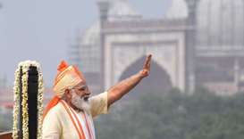 India's Prime Minister Narendra Modi waves after his speech to the nation during a ceremony to celeb