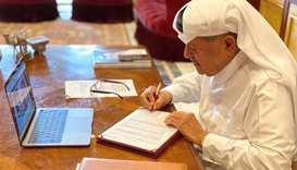 Sheikh Faisal signing the agreement.