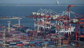 Containers are seen at the international cargo terminal at the port in Tokyo. Japan's economy shrank