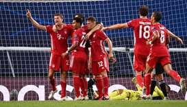 Bayern Munich's Serge Gnabry celebrates scoring their second goal with teammates