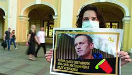 Putin critic Navalny fights for life, aides suspect poisoning