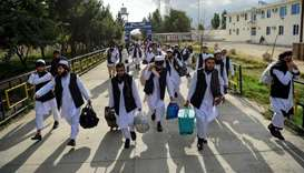 Taliban prisoners walk as they are in the process of being potentially released from Pul-e-Charkhi p