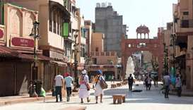 People walks near closed shops at the Heritage Street after strict lockdown norms for weekends and p