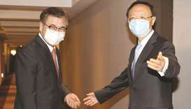 South Korea's national security adviser Suh Hoon (left) and Yang Jiechi, a member of the Political B
