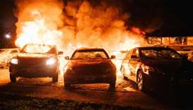 Wisconsin city center torched amid protests over police shooting of Black man