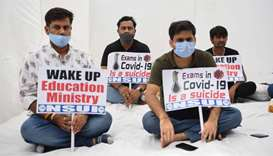 Activists of the National Students Union of India (NSUI ) take part in a demonstration demanding pos