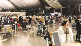 Filipino expatriates queue up for the repatriation flight at Doha's Hamad International Airport on F