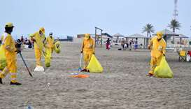 Workers deputed by the General Cleanliness Department of MME cleans the beach