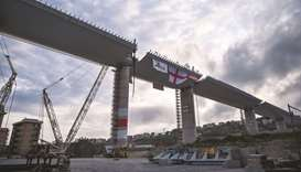 This file photo taken on April 27, shows the last 44m span that is being hoisted between columns 10