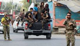 Afghan security forces transport detained prisoners who escaped from a jail after insurgents attacke