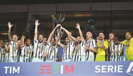 Juventus players celebrate being crowned champions at the end of the Serie A match against Roma on S