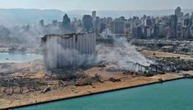 An aerial view shows the massive damage done to Beirut port's grain silos (C) and the area around it